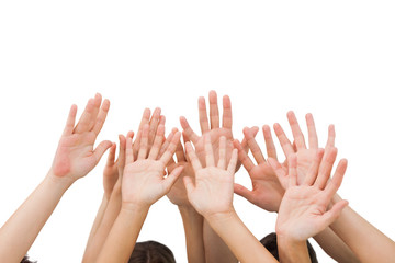 People raising hands in the air