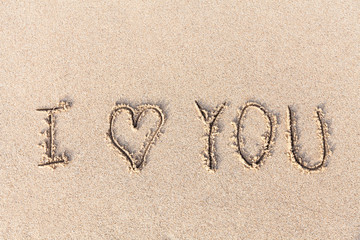 I love you handwritten in sand for natural