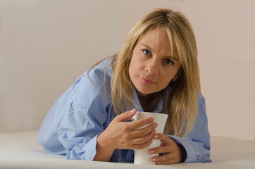 young beautiful woman is drinking coffee