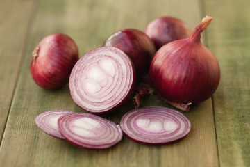 Homegrown red onion on vintage table
