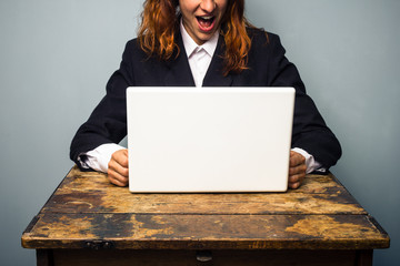Businesswoman is excited about her laptop