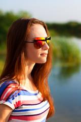 portrait of beauty girl wearing sunglasses outdoors