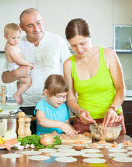 family of four making dumplings with raw fish rolls and test