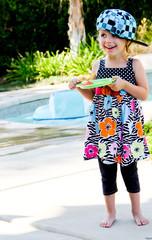 Toddler eating watermelon at pool 2