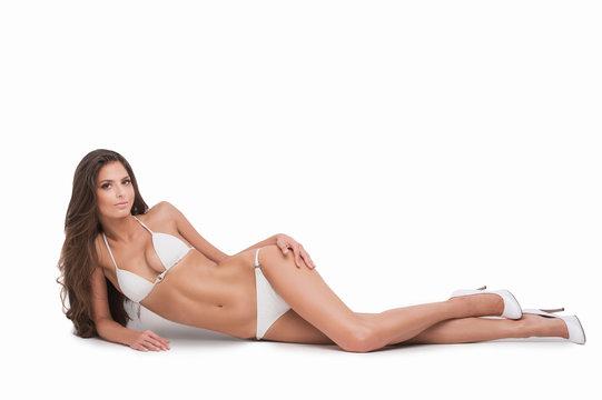 Beauty in white bikini. Beautiful young woman in white bikini ly