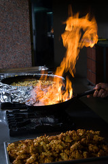 Chef cooking flambe dish