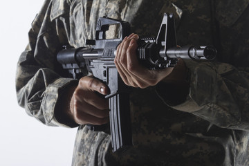 Military man holding gun, horizontal