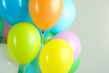 Colorful balloons on grey background