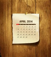 Calendar April 2014 vintage paper on wood background