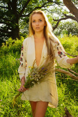 Pretty woman in the summer forest