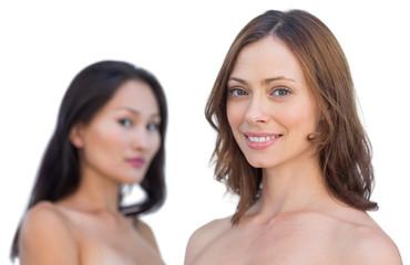 Attractive nude models posing smiling at camera