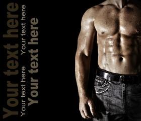 Bodybuilder posing on the black background