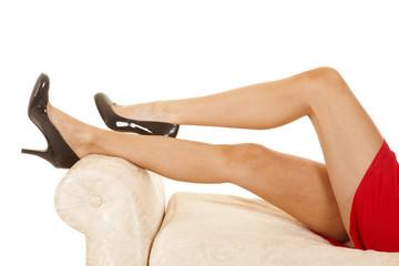 woman red dress close legs black heels