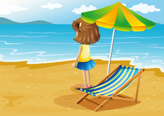 A girl at the beach with a foldable chair and an umbrella