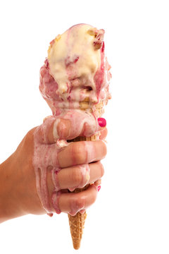 Ice cream melting in hand