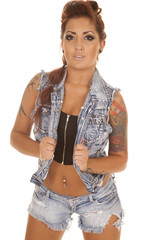 Woman tattoos denim vest facing