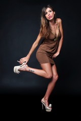 Sensual girl with brown dress