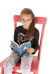 girl looking over nerdy glasses reading a book