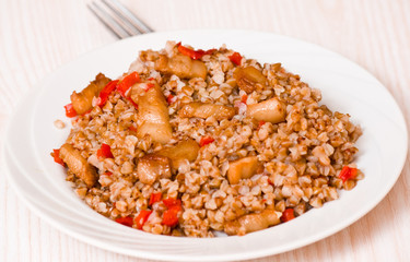 Buckwheat porridge with meat and pepper