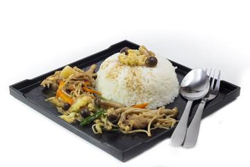 Mushrooms stir fry with rice on black plate