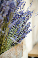 Violet dry lavender flowers in wooden box