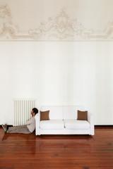 interior home, comfortable white sofa with man