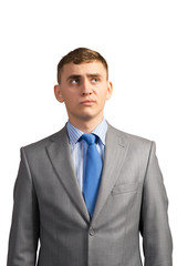 young businessman thinking and looking up