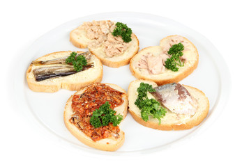 Tasty sandwiches with tuna and cod liver sardines different
