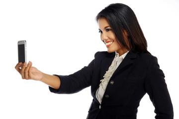 Cute brunette woman taking photo of herself