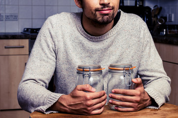 Man with two jam jars
