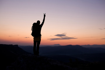man show concept of success on top of mountains