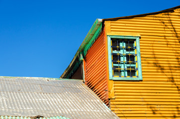 Fototapete - Orange Building and Blue Sky