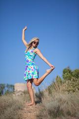 Beautiful young woman wearing bright dress