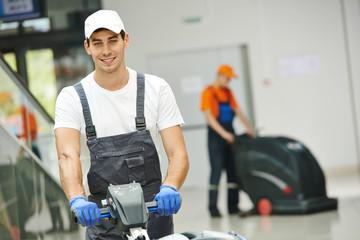Obraz male worker cleaning business hall - fototapety do salonu