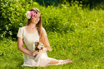 beautiful girl with bouquet of flowers in outdoor