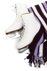 Figure skates with scarf isolated on white