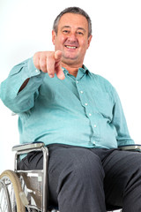 Man in wheelchair pointing the finger