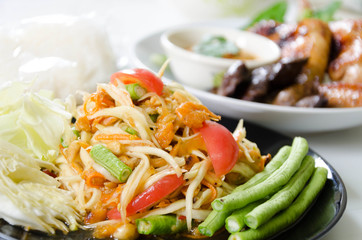 Spicy papaya salad somtum  and Roasting chicken