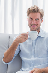Cheerful man drinking a coffee