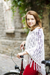 Woman in red hold tightly after bicycle