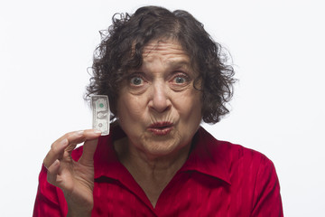 Dissatisfied woman holding dollar bill, horizontal