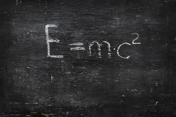 Chalk on black board: E=mc2 formula