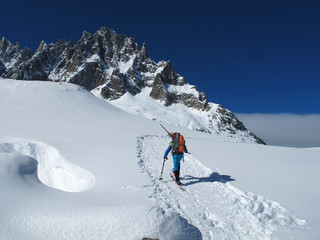 Young man doing ski touring in winter Alps