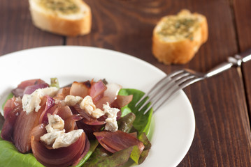 Appetizing baked red onion salad