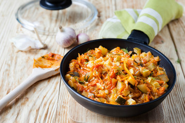 vegetable stew with courgettes in a frying pan