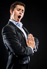 Opera singer performing over black background