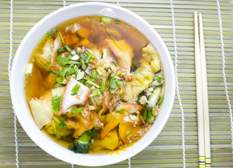Soup with sliced pork and dumplings