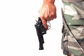 with a gun and camouflage pants close up over white background