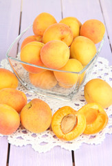 Fresh natural apricot in bowl on wooden table