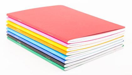 multicolored exercise books
